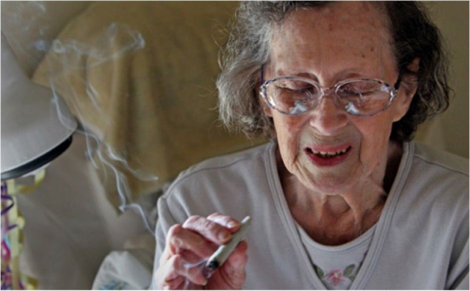 An elderly lady smokes pot.
