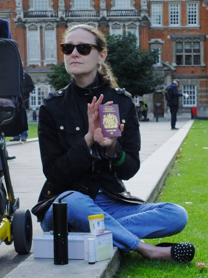 Ms X with Bedrocan and passport at the London Cannabis Hypocrisy protest outside Parliament.