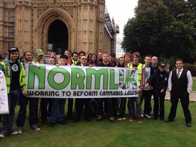 Photo-shoot of the organisers of NORML UK Cannabis Hypocrisy Protest outside Parliament.